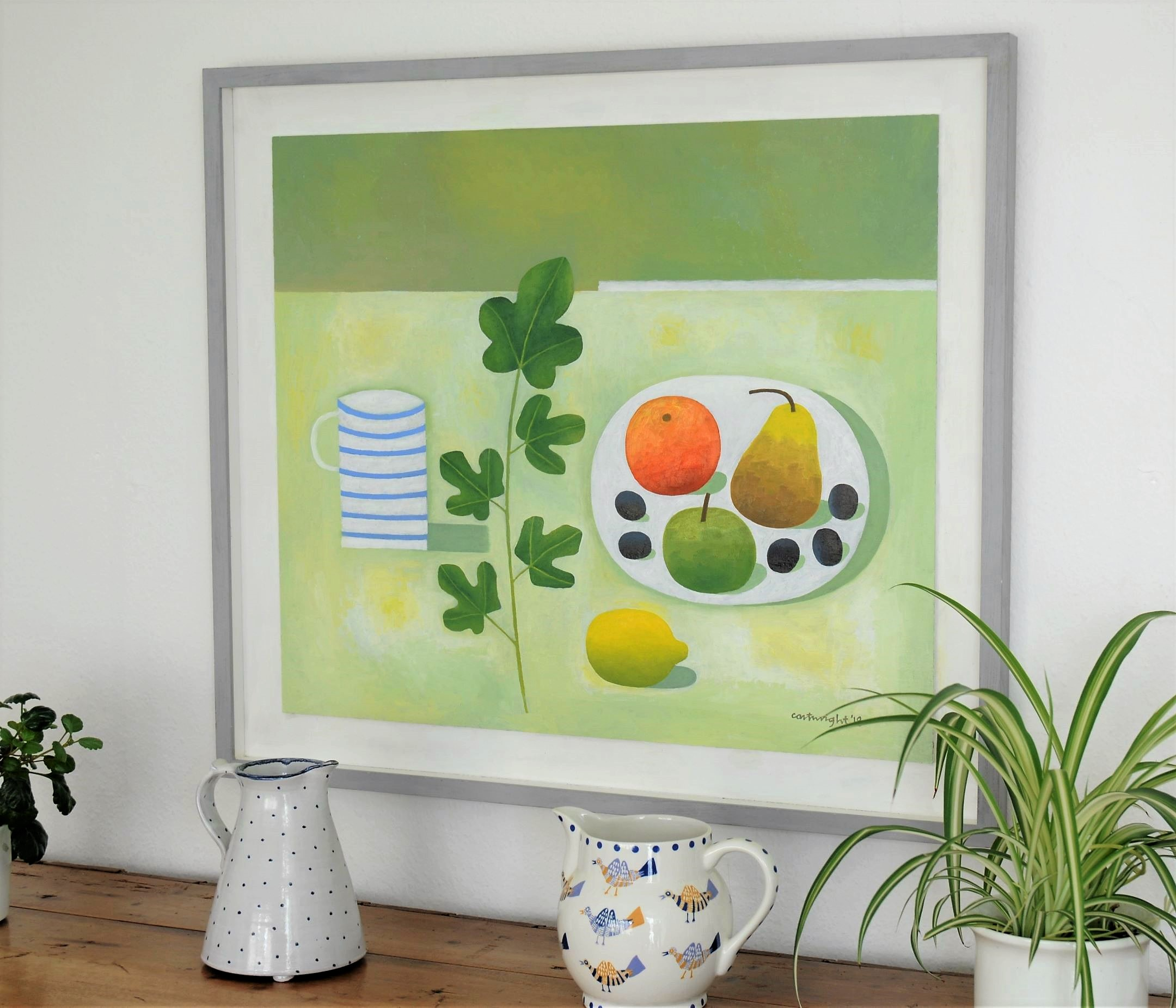 contemporary still life painting ina grey modern frame on wall with jugs in forground